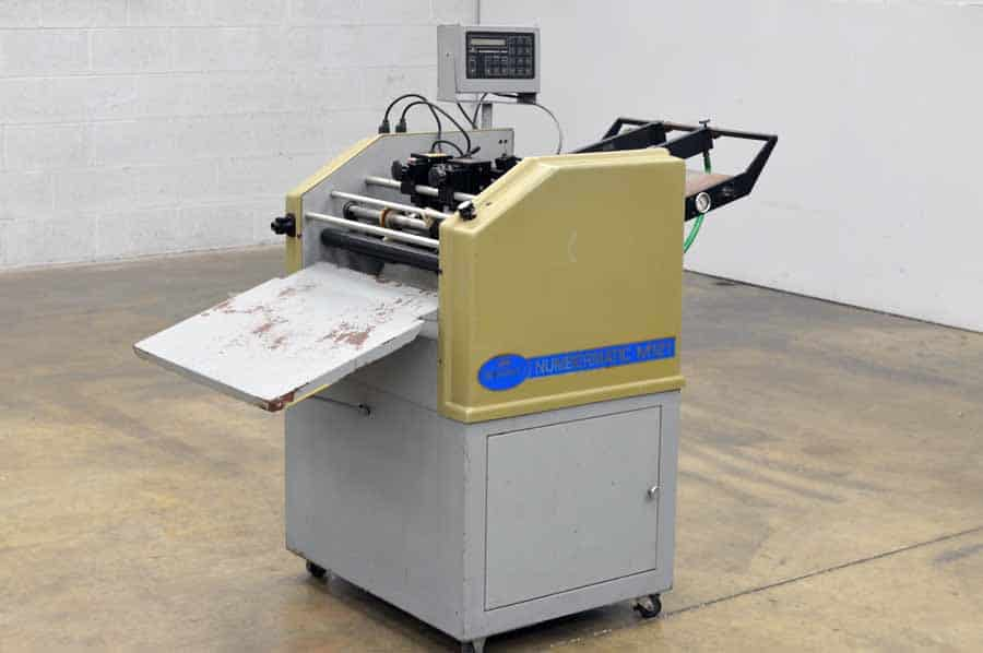 perforating and scoring machine
