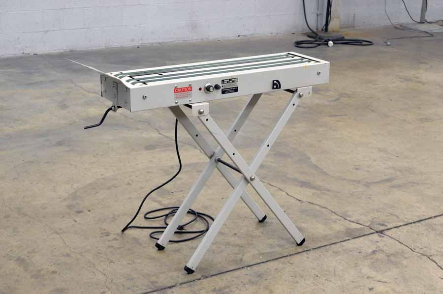 Press Specialty Model D-100 Receiving Conveyor