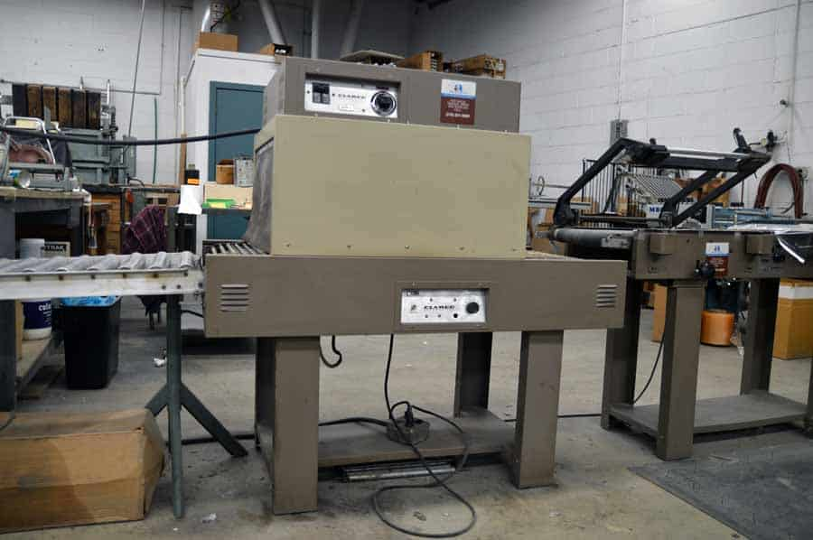 Clamco Shrink Wrap System w/ Magnetic Jaw Hold Down and Conveyor